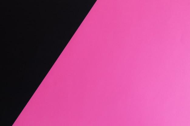 Surface de papier de couleur pastel noir et rose avec un espace pour le texte