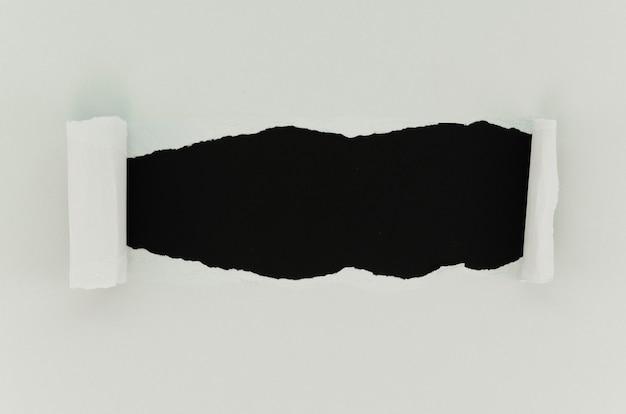Surface de papier déchiré noir et blanc