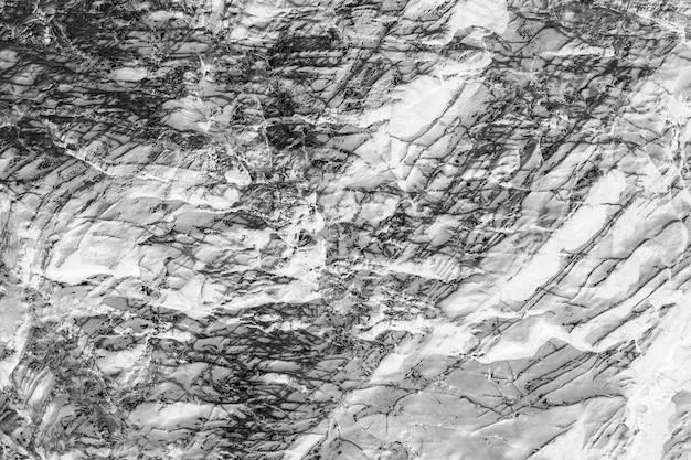 Surface en pierre noire et blanche. fond de marbre de texture.