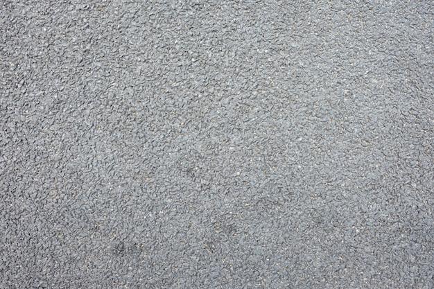 Surface de la route goudronnée du fond de la rue noire.