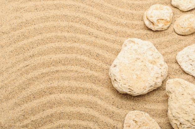 Surface de sable et de pierres de mer