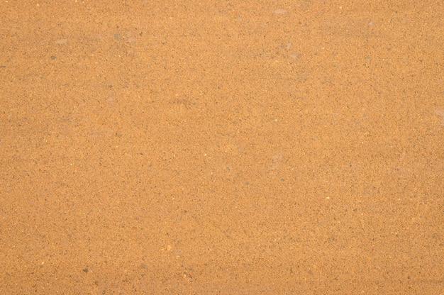 Surface de sable texturé comme arrière-plan, vue de dessus