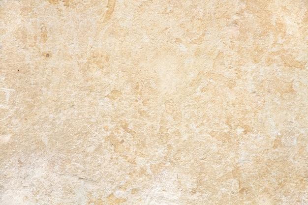 Surface en stuc beige brut