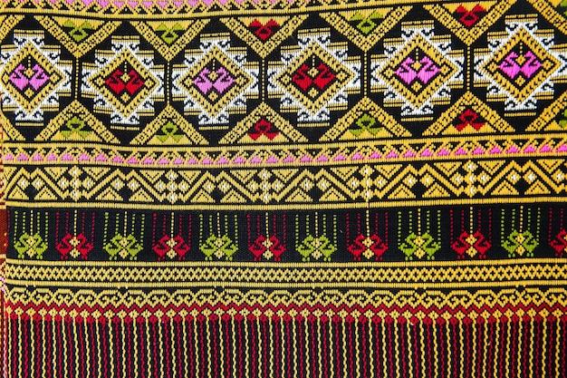 Surface de tapis de style coloré thaïlande se bouchent.