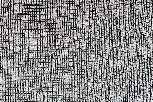Surface de tapis de style péruvien africain gris.
