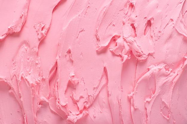 Surface de la texture de la crème glacée. fond de close-up de crème glacée aux fraises.