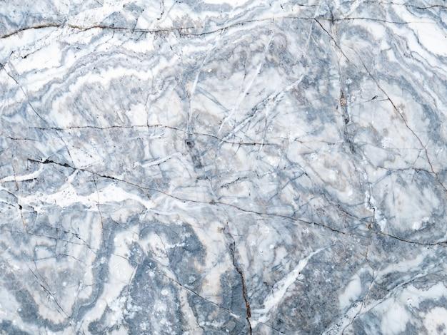 La surface de la texture de la pierre de marbre gris clair. plus d'un million d'années