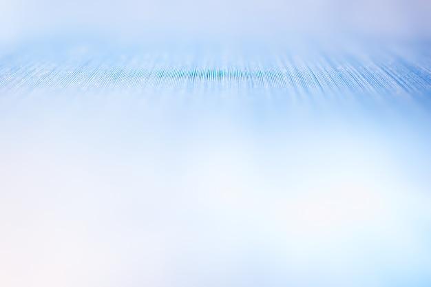 Surface texturée avec un arrière-plan flou de fuite de lumière pâle dramatique