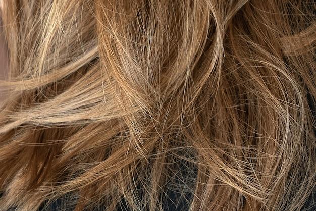 Surface texturée de cheveux blonds de couleur naturelle