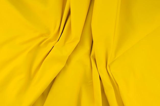 Surface texturée jaune gros plan