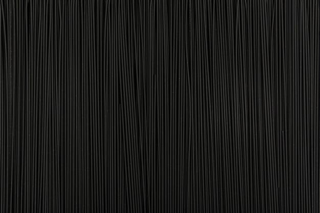 Surface texturée noire. abstrait noir. spaghetti