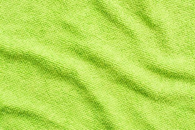 Surface de tissu microfibre vert, macro motif textile