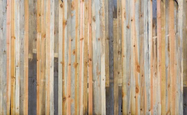 Surface de la vieille table en bois, fond avec des planches roses avec une texture distincte