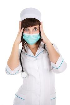 Surpris femme médecin ou infirmière en masque, isolé