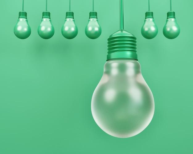 Symbole de l'ampoule sur une simple surface vert pastel