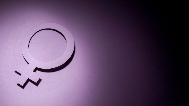 Symbole féminin fond violet noir dégradé