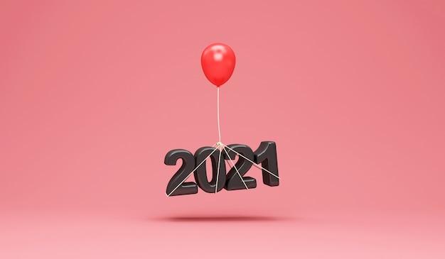 Symbole de nouvel an noir 2021 avec ballon rouge sur fond de studio rose