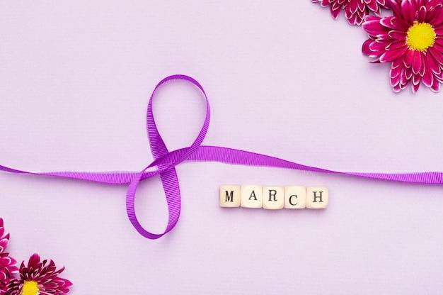 Symbole de ruban de la journée de la femme mignonne avec des fleurs
