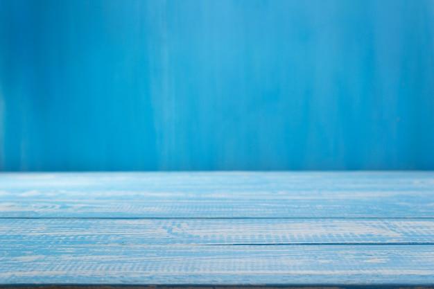 Table en bois bleue vide devant, surface de texture de fond de planche de planche