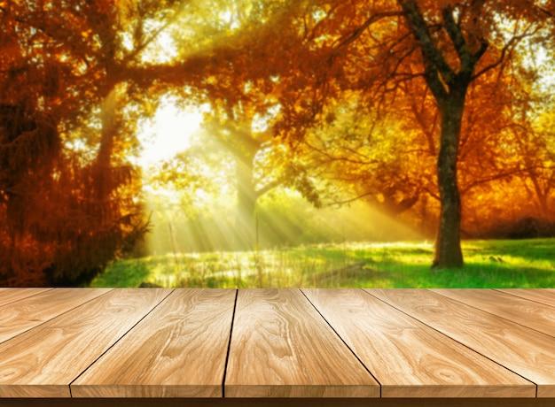 Table en bois dans le paysage d'automne avec un espace vide.