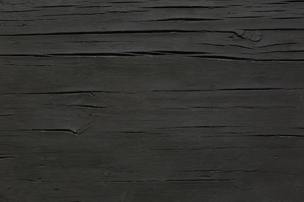 Table en bois noir mat
