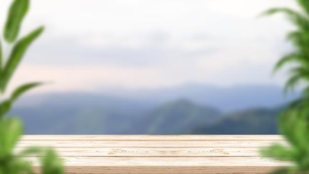 Table en bois vide avec des plantes et paysage flou de montagne pour l'affichage du produit de montage.