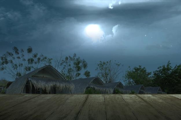 Table en bois avec vue sur la station balnéaire fantasmagorique avec scène de nuit et de clair de lune