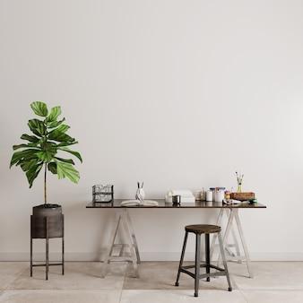 Table et chaises avec des plantes vertes devant le mur blanc