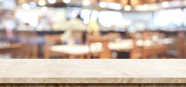 Table de ciment brun vide sur fond de café flou, montage d'affichage de produits et aliments