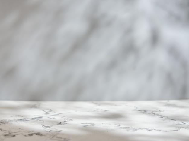Table et mur en marbre avec lumière et ombre naturelles