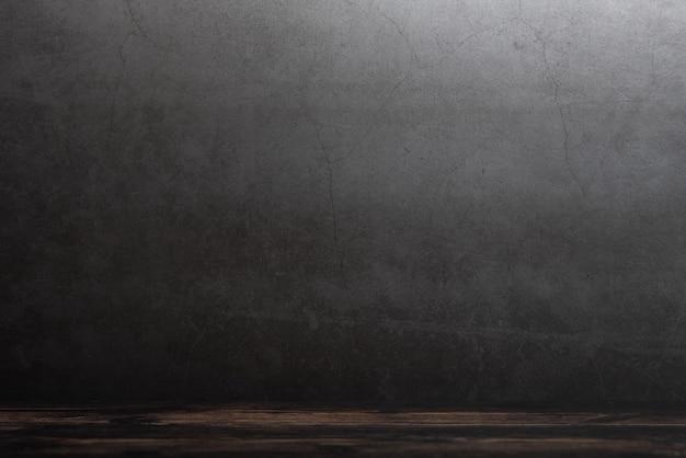 Table de terrasse en bois sur fond gris grunge