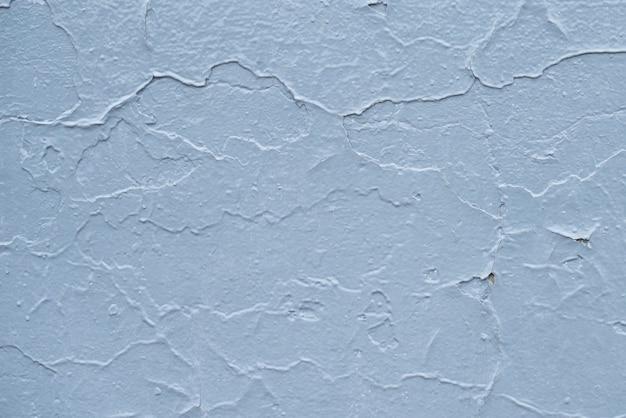 Tableau bleu avec des fissures de peinture. vieux fond de mur