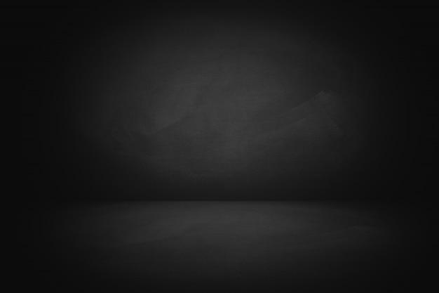 Tableau de craie noire avec fond de studio
