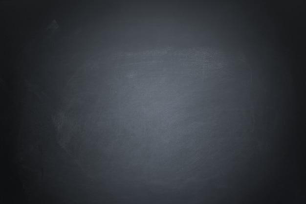 Tableau de craie de texture sombre et fond de tableau noir grunge