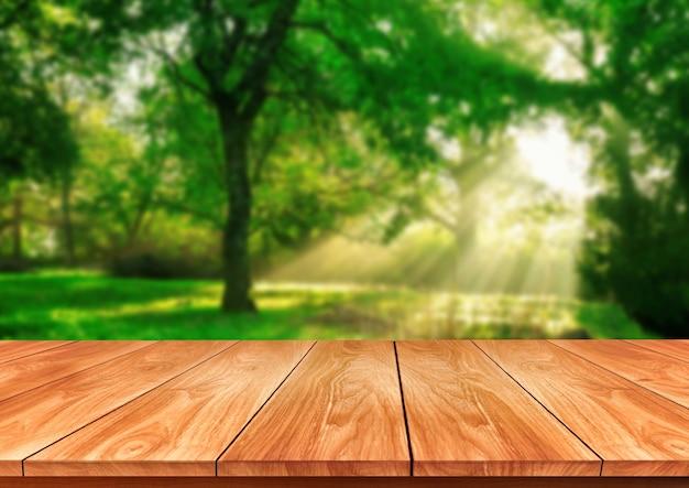 Tableau dans la nature flou vert avec espace copie vide sur la table pour l'affichage du produit