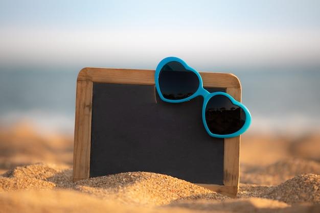 Tableau noir avec espace copie sur la plage
