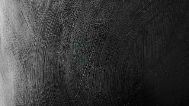 Tableau noir lavé. tableau noir humide. texture d'une surface noire
