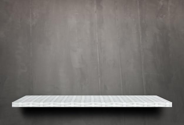 Tablette blanche vide sur ciment gris pour la présentation du produit
