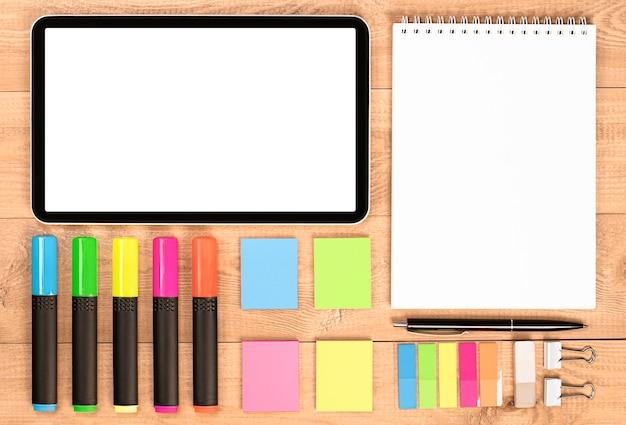 Tablette numérique, bloc-notes, surligneurs, autocollants, gomme, trombones. concept de knolling