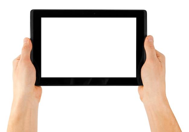 Tablette sur une surface blanche