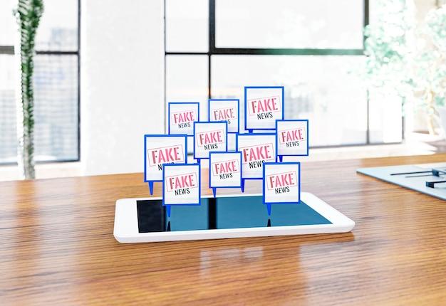 Tablette sur la table avec de fausses nouvelles