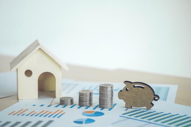 Tableur d'actions bancaires financières avec maison, pile pièce et piggy sur les données comptables