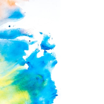 Tache d'aquarelle bleue et jaune