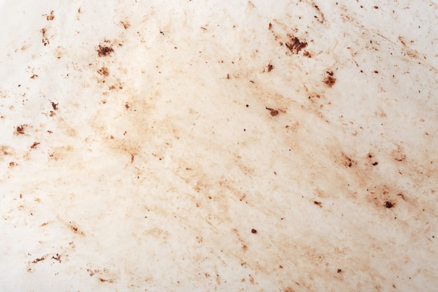 Tache de chocolat sur la texture du papier sulfurisé et l'arrière-plan