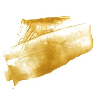 Tache de peinture dorée isolée sur fond blanc. texture dorée brillante faite avec un couteau à palette.