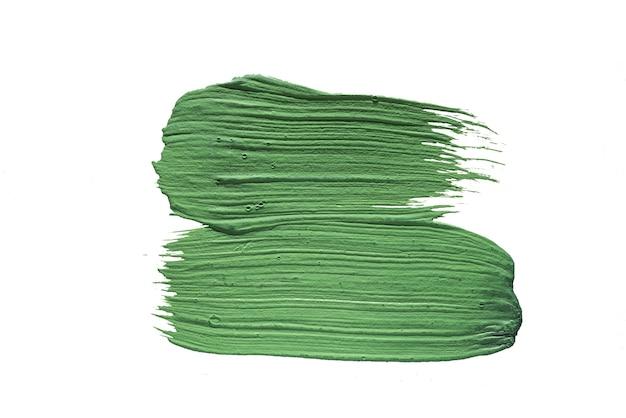 Tache de peinture à l'huile verte isolée sur fond blanc