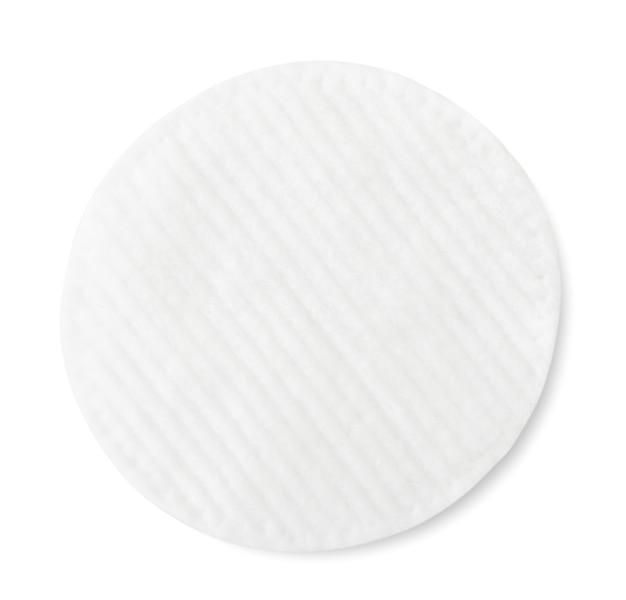 Tampon de coton gros plan sur fond blanc. vue de dessus