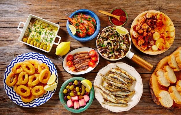 Tapas fruits de mer palourdes crevettes anchois calamars