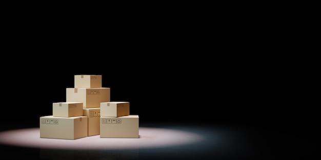 Des tas de boîtes en carton fermées sur fond noir