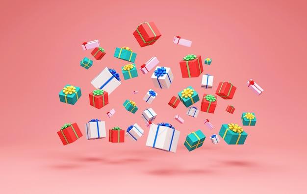 Tas de coffrets cadeaux couleur sur fond rose studio